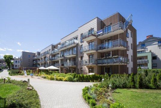 Apartamentowiec - posesja z patio