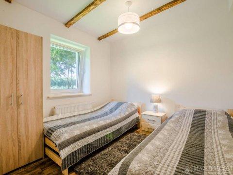 sypialnia w apartamencie kameralnym