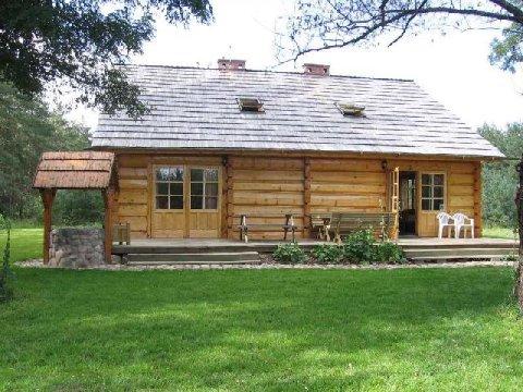 Widok od strony tarasu. - Chata Na Skrzynce. Ekologiczny dom z drewnianych bali nad Jeziorem Powidzkim