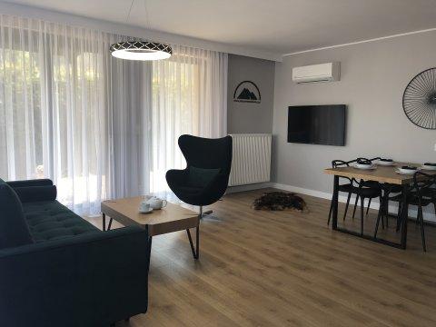 Salon z aneksem kuchennym - Plażowa Residence