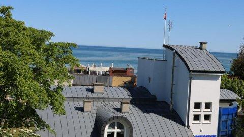 Apartament z widokiem na morze i latarnię morską